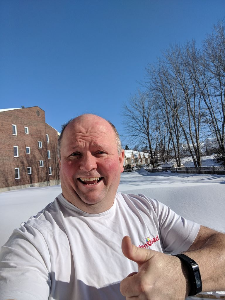 Adrien Laroche taking a selfie in the snow with his thumb up